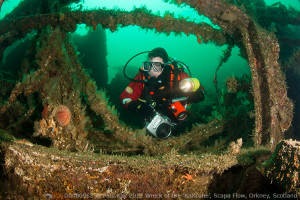Underwater photographer with Seacam Silver housing on the wreck of the SMS Karlsruhe in Scapa Flow